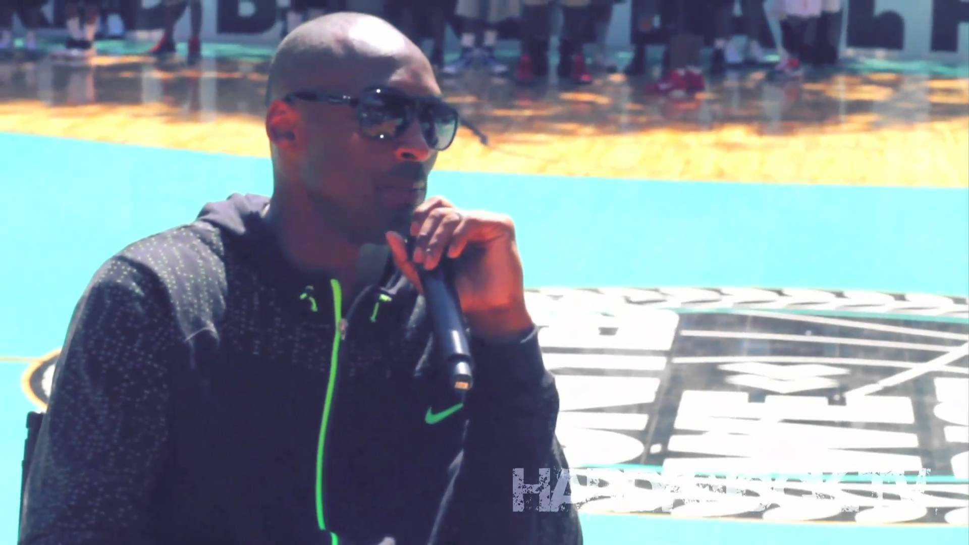 Kobe Bryant gives advice to players at Rucker Park